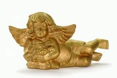 Golden Angel. Decorativ golden angel on bright background stock images