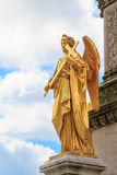 Golden angel with a cross Royalty Free Stock Photo