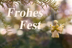 Golden angel with german 'Frohes Fest' (Merry Christmas) Stock Image