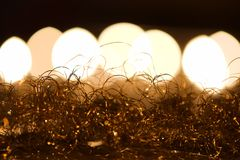 Golden angel hair with candlelight. Christmas decoration: golden angel hair against candlelight bokeh background Stock Photo
