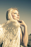 Golden Angel Looking To The Heavens. Golden Female Angel Wearing White Feather Wings While Looking To The Heavens Above In A Depiction Of Faith And Belief Royalty Free Stock Image