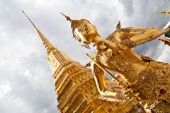 Golden Angel with Pagoda Wat Pra Kaeo, Thailand Stock Images