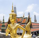 Golden Angel with Pagoda in Wat Pra Kaew, thailand. Golden Angel with Pagoda in Wat Pra Kaew it give the history of this place in the past stock photos
