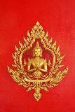 Golden god (Deva) on the red wall Thai art Stock Photography