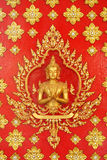 Golden god (Deva) on the red wall Thai art Stock Images