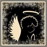 Golden angel silhouette in the golden frame with stars glitter. Religious symbol. Royalty Free Stock Photography