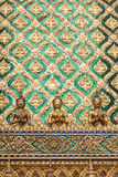 Golden angel statue and decorated wall with thai art Stock Image