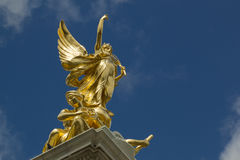 Golden angel statue monument in London. Golden winged angel above stone memorial outside Buckingham Palace in Westminster, London, UK Stock Images