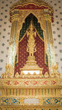 Golden angel statue and  Thai art architecture detail main ordination hall. Stock Photography
