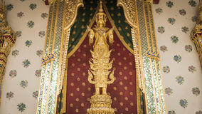 Golden angel statue and  Thai art architecture detail main ordination hall. Royalty Free Stock Photo