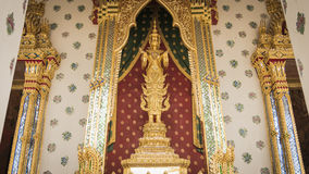 Golden angel statue and  Thai art architecture detail main ordination hall in Wat Arun buddhist temple , Thailand Stock Photo