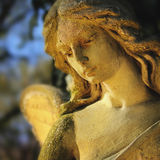 Golden angel in the sunlight (antique statue) Royalty Free Stock Photos