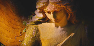 Golden angel in the sunlight (antique statue) Stock Images