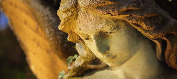 Golden angel in the sunlight (antique statue) Stock Photo