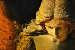 Golden angel in the sunlight (antique statue) Stock Image