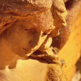 Golden angel in the sunlight (antique statue) Stock Photos