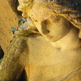 Golden angel in the sunlight (antique statue) Stock Photography