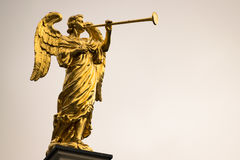 Golden angel with a trumpet and copy space. Royalty Free Stock Photo