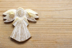 Golden angel on wooden background. stock photography