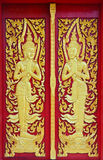 Golden angle sculpture at Thai temple door Royalty Free Stock Images