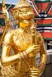Golden Angle at Wat Phra Kaeo, Temple of the Emerald Buddha and. The home of the Thai King. Wat Phra Kaeo is one of Bangkok`s most famous tourist sites and it Royalty Free Stock Photo