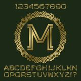 Golden angular letters and numbers of two stripes.. Golden angular letters and numbers of two stripes. Monogram in decorative round frame. Fashion presentable Royalty Free Stock Image