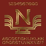 Golden angular letters and numbers of two stripes. Monogram with wings. Fashion presentable font kit for logo design Royalty Free Stock Photo