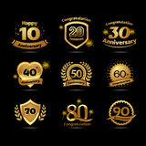 Golden Anniversary happy holiday festive celebration emblems set with ribbons isolated vector illustration. Black background. Golden Anniversary happy holiday Stock Photo