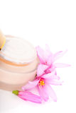 Anti aging moisturiser lotion. Golden anti aging cream moisturiser with pink flower on white background. Luxurious cosmetic background Royalty Free Stock Photos