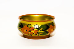 Golden antique bowl. An isolated view of an antique, golden bowl with decorative floral designs Royalty Free Stock Photography