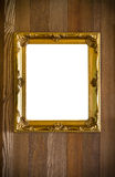Golden antique frame on wood background Stock Photo