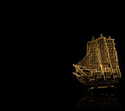 Golden antique ship with reflection Stock Photo