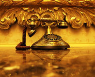 Golden Antique Telephone Stock Image