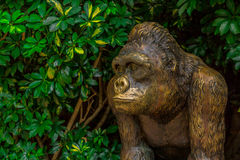 Golden Ape Statue. A golden ape statue surrounded by nature Royalty Free Stock Photography