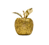 Golden apple. Gold glitter apple ornament on white stock image