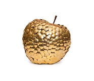 Golden apple. Metal golden apple  on a white background Royalty Free Stock Photos