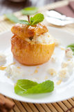 Golden apple baked with curd cheese and honey Stock Photo