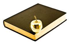 Golden Apple on Bible Stock Photos