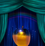 Golden Apple before Curtains Royalty Free Stock Photos