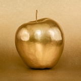 Golden apple on gold background Royalty Free Stock Image
