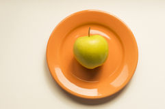 Golden apple. Ideal for wallpapers. Could be useful in presentations, web and printing design Royalty Free Stock Photos