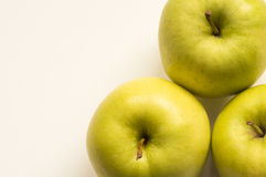 Golden apple. Ideal for wallpapers. Could be useful in presentations, web and printing design Stock Image
