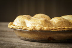 Golden Apple Pie on Rustic Barnwood Royalty Free Stock Images