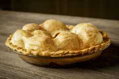 Golden Apple Pie on Rustic Barnwood Stock Image