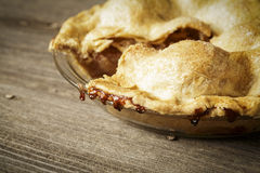 Golden Apple Pie on Rustic Barnwood With One Slice Gone Royalty Free Stock Photos