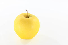 Golden Apple. That is placed on a white background Stock Images