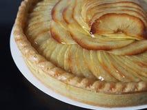 Golden apple tart, black surface Stock Photo