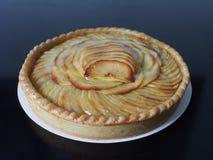 Golden apple tart, black surface Stock Photography