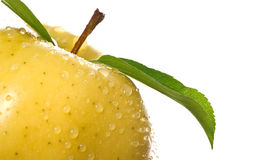 Golden Apple with Water Drops Stock Photo