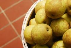 Golden apples. Basket full of fresh golden apples Stock Image